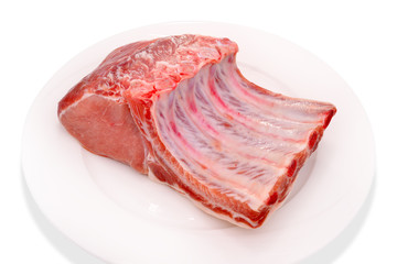 Raw pork on white plate isolated on white background.
