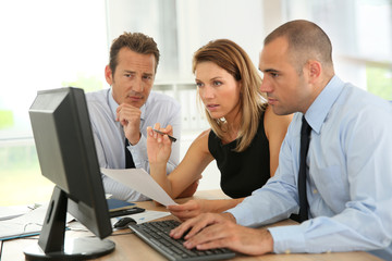 Business people working on desktop computer