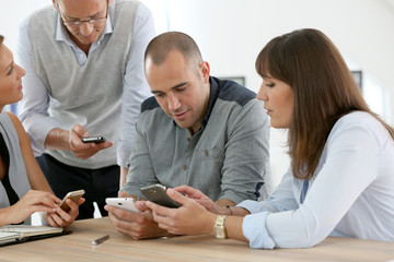 Business group meeting with smartphones
