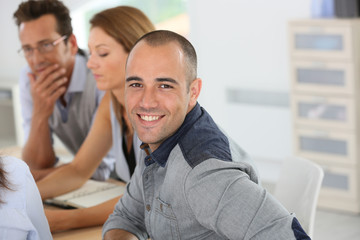 Smiling young businessman attending business training