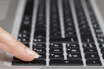 woman pressing enter key