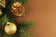 Beautiful Christmas decorations on fir tree on brown background