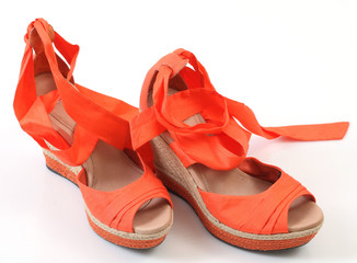 women's orange fashion sandals on a high thatched platform sole