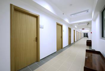 empty long corridor modern office building interior