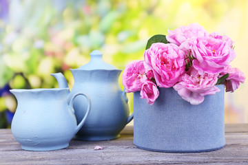 Breakfast tea with  teapot of fresh pink garden roses