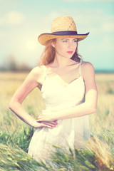 Beautiful young woman in field