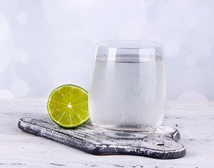 Cool water in glass, on light background