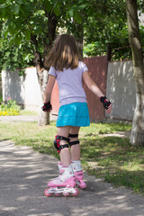 little girl on roller skates