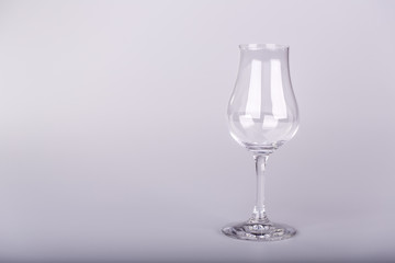 Empty glass for rum on white background