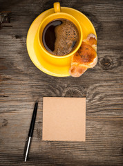 Coffee croissant and notepads