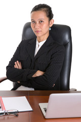 Asian businesswoman sitting at her office chair