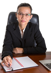 Asian businesswoman at her office desk over white backfground