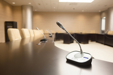 microphone on table at empty conference room
