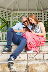 Young couple using a tablet PC