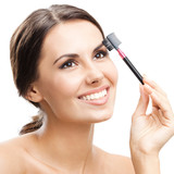 Smiling woman with make up brush, isolated