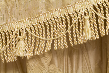 Detail of curtains with fringe and tassels
