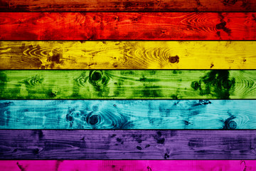 Grunge colorful wood planks background in rainbow colors.