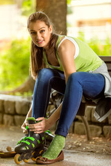 Attractive young girl with rollerblades