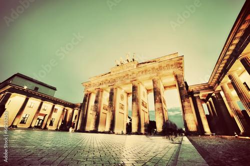 Fototapeta Brandenburg Gate, Berlin, Germany at night. Vintage, retro