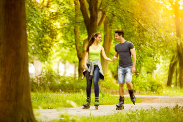 couple ride rollerblades