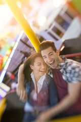 Happy couple enjoy in riding ferris wheel