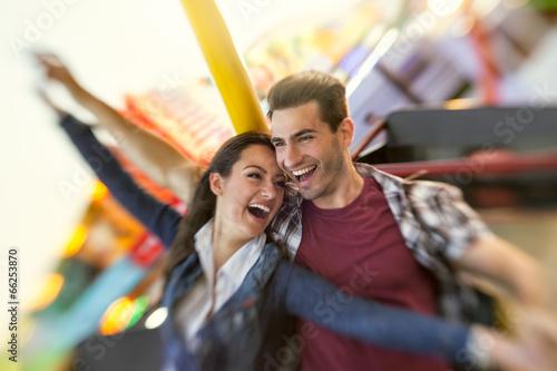 Leinwandbild Motiv Laughing couple enjoy in riding ferris wheel