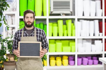 Male florist Holding an blank chalkboard