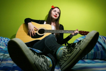 Brunette playing guitar