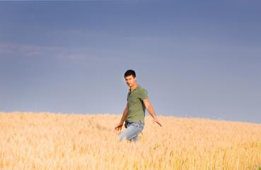 Attractive man in barley field