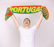 Man supports Portugal team with Portuguese scarf.