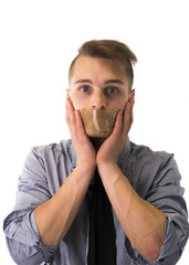 Handsome young man with duct tape on mouth cannot speak