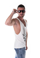 Handsome young man in white tanktop and sunglasses