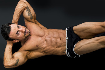 Attractive muscle man laying on the floor