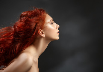 red-haired girl with flying hair