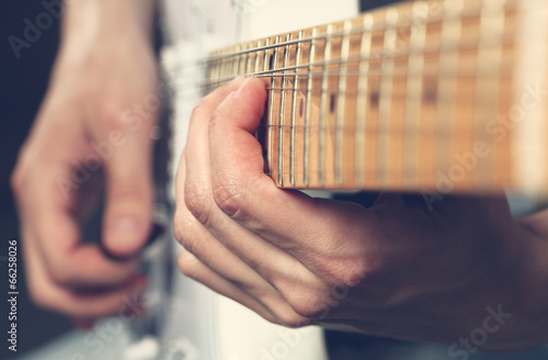 Guitarist playing an electric guitar