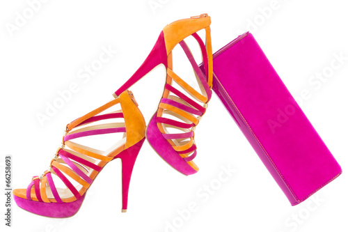 Pare of pink and orange shoes and a matching bag, isolated on wh