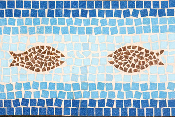 Image of a mosaic showing a underwater world with a fish
