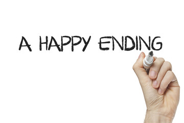 Hand writing a happy ending