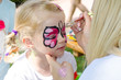 child with face painting - 66260471