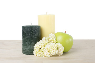 candle set on a wood table and on a white background.