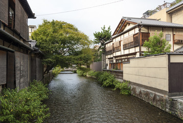 river and houses in kyoto japan