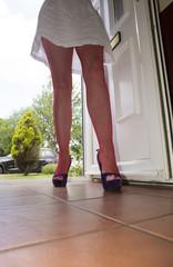 Woman walking through the front door