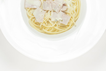 spaghetti with cream sauce top view on a white background.