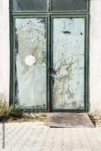 Dirty old shop door