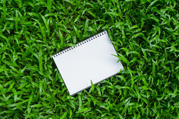 a note pad on green grass
