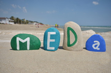 Meda, souvenir on stones over the sand