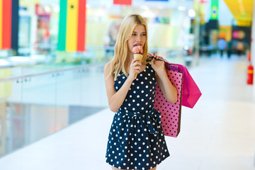 teen girl with ice cream and shopping bags