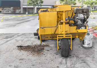 Paver grader road resurfacing vehicle in suburban parking lot