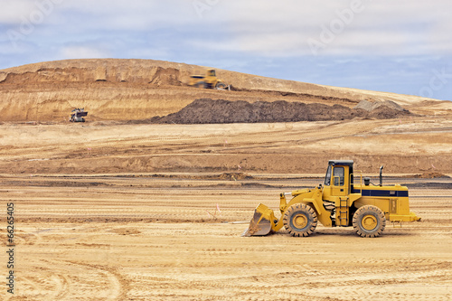 Heavy construction loader vehicle at worksite,sky background - 66265405