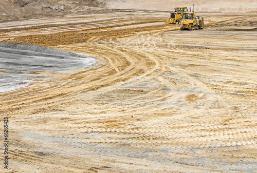 Construction site sandy soil wide open space, tire tracks - 66265423